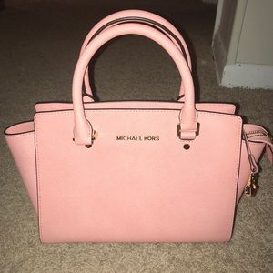 Pink Michael Kors purse with matching wallet